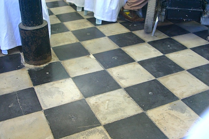 The checkerboard tile floor
